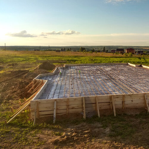 Image of a slab foundation being prepared.