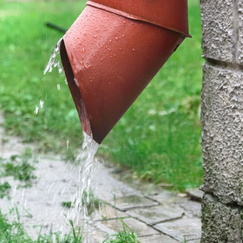 Closeup of Rainwater Flowing From a Drainpipe